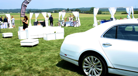 study-of-Iride-Bentley-coach-automobile-comparing-with-Iride-bicycles-velocipede-at-Hamptons-brunch-party-show-iride-bicycles-booth-side-view