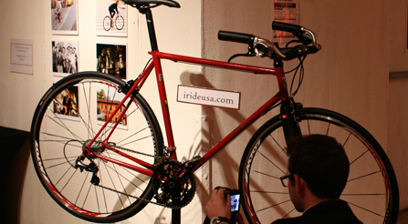 image of A fan making photographs of iride details. Party guests enjoying the glow of high performance Italian bicycles