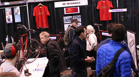 photo of curious people occupy IRIDE italian booth at NAHBS North American Handmade Bicycle Show urban bikes