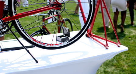booth-at-Many people enjoy the summer grass in the Hamptons.-bike-show