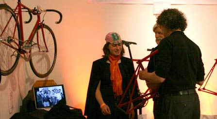 n-demonstrating-remarkable-IRIDE-bicycle-frame-lightness-NYC-lightweight-urban-bikes-woman-girl-lady-female IRIDE-usa--bicycle-show-cicli-iride-fine-italian-bikes-made-in-italy-cycles-artisanal-unique-special-vehicles