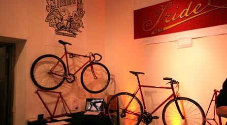 curious-occupy-Dramatic lighting in the big booth at the show in SOHO.-urban-cycling-master-held-above photo